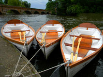 Rowboats moored at Straford-Upon-Avon. These 3 empy boats are awaiting passengers, moored at the famous Straford-Upon-Avon England Stock Image