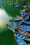 Rowboats at the Phewa lake. Colourful rowboat at the Phewa lake Stock Photos