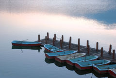 Rowboats in pier Stock Image