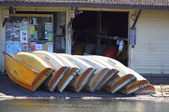 Row boats piled at general store Royalty Free Stock Photos