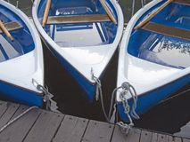 Rowboats after the rain. Three tethered rowboats after the rain Royalty Free Stock Photography