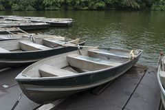 Rowboats for rent to paddle in lake stock photography