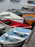 Rowboats in a Row. Rowboats lined up at a dock Royalty Free Stock Image