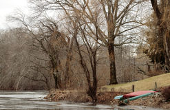 Rowboats on the shore. Colorful rowboats awaiting the thaw Stock Photography