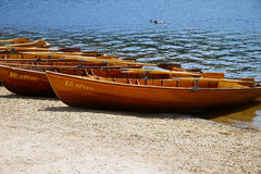 Rowboats on the shore of a lake Royalty Free Stock Images