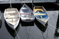 Rowboats. Three rowboats moored at a dock Stock Photo