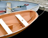 Rowboats Tied to a Pier. Rowboats tied to a pier in a marina in Maine Stock Images