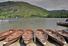 Rowboats on Ullswater. Rowboats on the shore of Ullswater at Glenridding in the English Lake District Royalty Free Stock Image