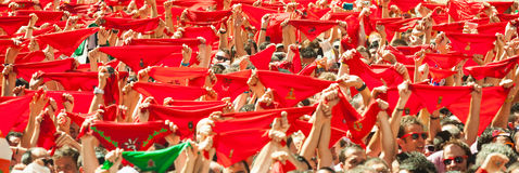 Сrowd raises red scarves in waiting for the opening of  San Fer Royalty Free Stock Photo