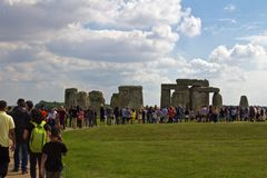 Rowd Stands in Front of the Rocks of Stonehenge. Amesbury, United Kingdom- September 2018, Crowd Stands in Front of the Rocks of Stonehenge On a Cloudy Summer stock photo