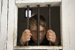 Rowdy behind ancient prison bars Royalty Free Stock Photography