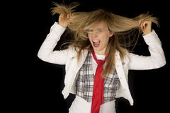 Rowdy and excited girl pulling her hair black background Stock Images