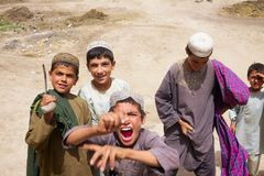 Rowdy Kids in Kandahar Afghanistan. A group of kids play together in a village square in Kandahar Province, Afghanistan Stock Photography