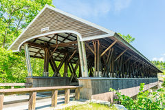 Rowell Covered Bridge. Is a covered bridge in Hopkinton, New Hampshire which carries Rowell Bridge Road over the Contoocook River. It is a long truss style Royalty Free Stock Photo