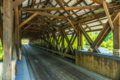 Rowell Covered Bridge. Is a covered bridge in Hopkinton, New Hampshire which carries Rowell Bridge Road over the Contoocook River. It is a long truss style Royalty Free Stock Photos