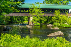 Rowell Covered Bridge. Is a covered bridge in Hopkinton, New Hampshire which carries Rowell Bridge Road over the Contoocook River. It is a long truss style Stock Photo