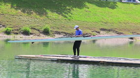 Rower finishing training on Jarun lake stock footage