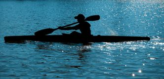 Rower (kayaker) on the water royalty free stock image