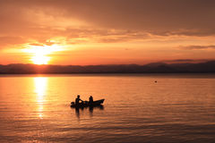 Rower at sunset. Image of silhouette, Rower at sunset stock photography