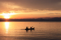 Rower at sunset. Image of silhouette, Rower at sunset stock photos