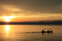 Rower at sunset. Image of silhouette, Rower at sunset royalty free stock photos