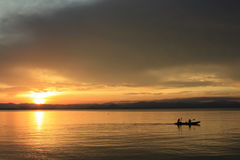 Rower at sunset. Image of silhouette, Rower at sunset royalty free stock photo