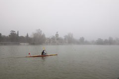 Rower in winter. A solitaire rower training in winter Royalty Free Stock Photography