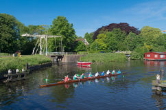 Rowers in canal Royalty Free Stock Image