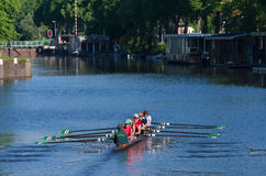 Rowers in canal Royalty Free Stock Photos