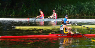 Rowers and colorful boats on the River Ouse Stock Photo