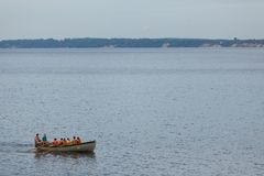 Rowers in lifejackets on a boat. Sail along the Gorky water reservoir on the Volga River royalty free stock photography