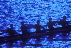 Rowers por claro de luna Foto de archivo libre de regalías
