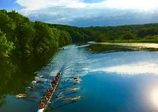 Rowers On A River. Rowers boating down a river Stock Image