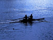 Rowers Silhuette In Blue. Just two rowers in boat during the practise Royalty Free Stock Photo