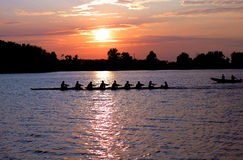 Rowers at Sunset Stock Photography