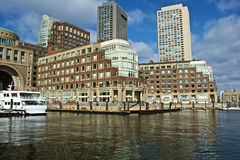 Rowes wharf building. View of boston harbor and rowes wharf and skyscraper buildings in boston massachusetts Stock Photography