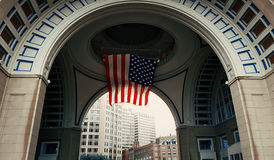 Rowes Wharf. Looking through the arch at Rowes Wharf, in Boston, Massachusetts. USA flag hoisted Royalty Free Stock Photo