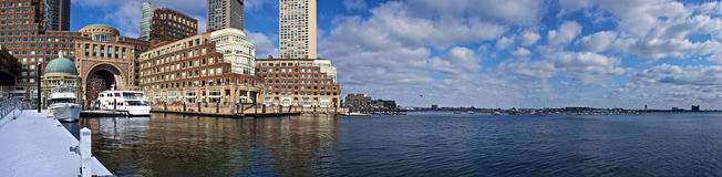 Rowes wharf panorama. Panoramic view of boston harbor with rowes wharf and skyscraper buildings in boston massachusetts on a cloudy winter day Stock Photography