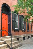 Rowhouse with Red Door. A brick rowhouse in Philadelphia with a bright red door Royalty Free Stock Photography