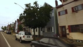 Rowhouses in Pittsburgh`s Bloomfield Area. Pittsburgh - circa September, 2016 - an establishing shot of typical row houses in the Bloomfield area of Pittsburgh stock video footage