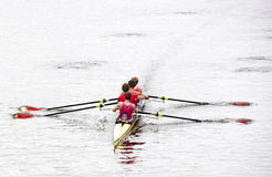 Rowing. Coxed four rowing towards the camera, on a bleak day in open water stock photo