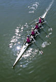 Rowing. Four girls rowing  on a sunny day Royalty Free Stock Image