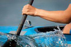 Rowing. Kayaker paddling on a boat Stock Images