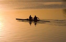 восход солнца rowing стоковое изображение