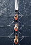 Rowing. Air view of three rowers on a skiff Royalty Free Stock Images
