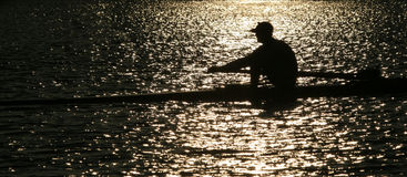 Rowing alone Stock Images