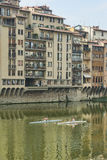 Rowing on the Arno River Stock Photography