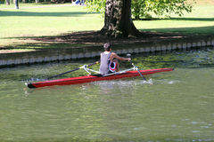 Rowing on Bedford river. A man rowing a single racing boat on the river Great Ouse at Bedford, UK Stock Photos