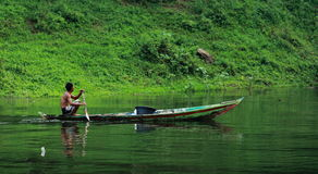 Rowing Boat. A man rowing traditional boat in the Jatiluhur lake Stock Images
