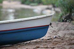 Rowing boat on the beach close to Royalty Free Stock Image